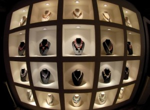 modern showcase full of  fashionables necklaces,  in chic boutique