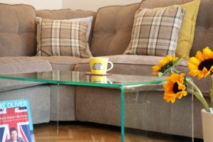 a glass effect Perspex coffee table