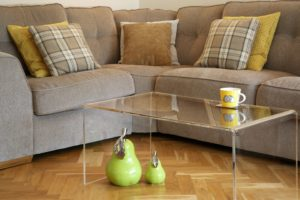 A clear Perspex coffee table