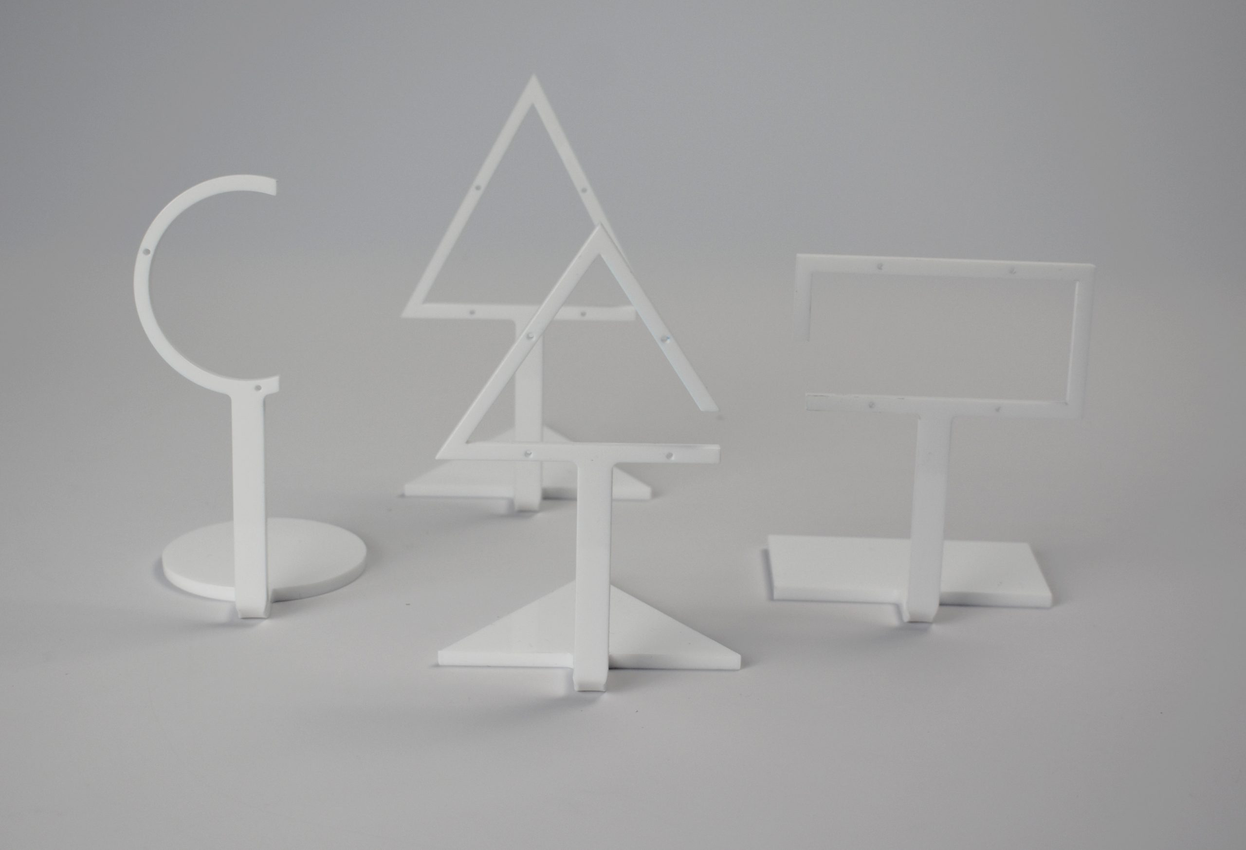 An image of Tall Triangle Earring Stand – White